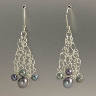 Hand knit fine silver earrings with black pearls by Kate Wilcox-Leigh
