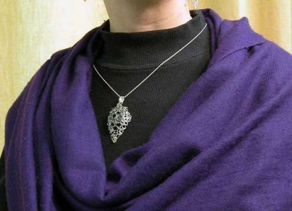 Hand knit leaf lace necklace medium polished and small oxidized on by Kate Wilcox-Leigh
