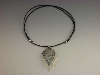 Hand knit leaf lace necklace large polished and medium oxidized on leather by Kate Wilcox-Leigh