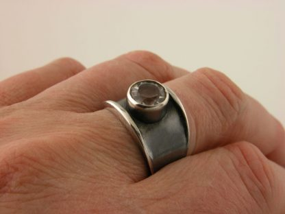 kate-wilcox-leigh-ring-thickened-edge-narrow-sterling-quartz-on-closeup