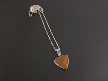Kate Wilcox-Leigh pendant sterling bezel set leather trillion small layed out